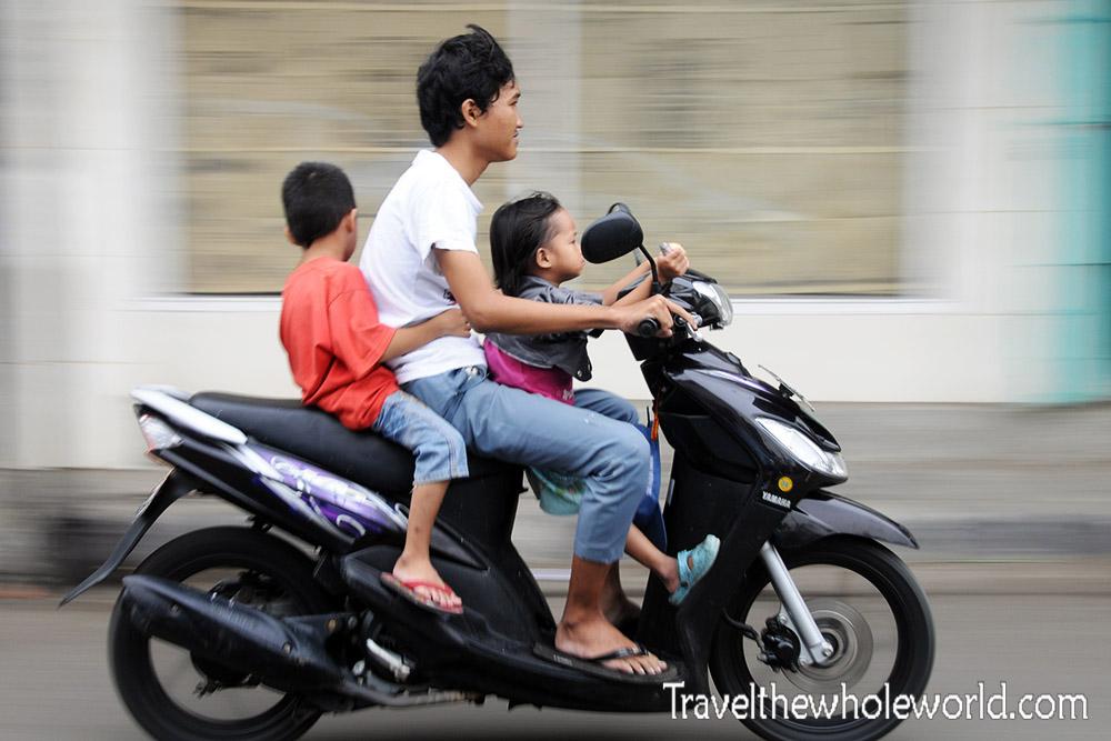 Travel Photos Indonesia Jakarta Family Motorcycle